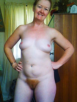 mature redhead hairy pussy stripping